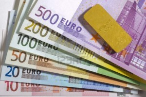 euro-banknotes-and-gold-bar