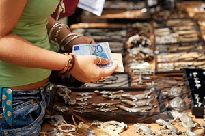 Paying With Euros At The Es Cana Hippy Market